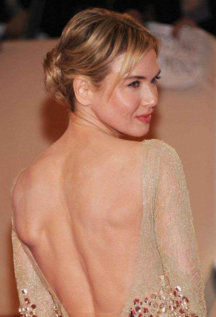 Centered buns tend to make the face look rounder, warns Mitchell. But Renee Zellweger's side-swept bangs combined with height at the top of her head elongate her face, offsetting its roundness.   - Redbook.com