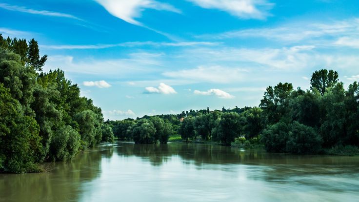 Flow - Rolling backwater of the Danube on a hot summer afternoon with only a few clouds covering the clear blue sky.   Taken with a 10 stop ND…