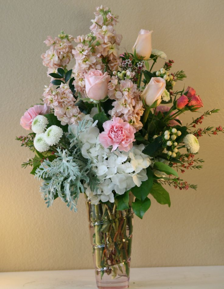 Peach and white flowers by Willow Branch Florist of