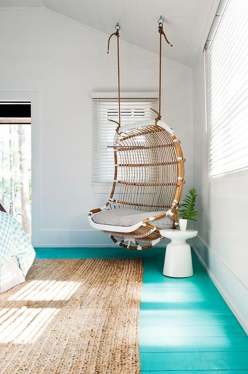 Beach Style Girl S Bedroom Boasts A Corner Rattan Chair
