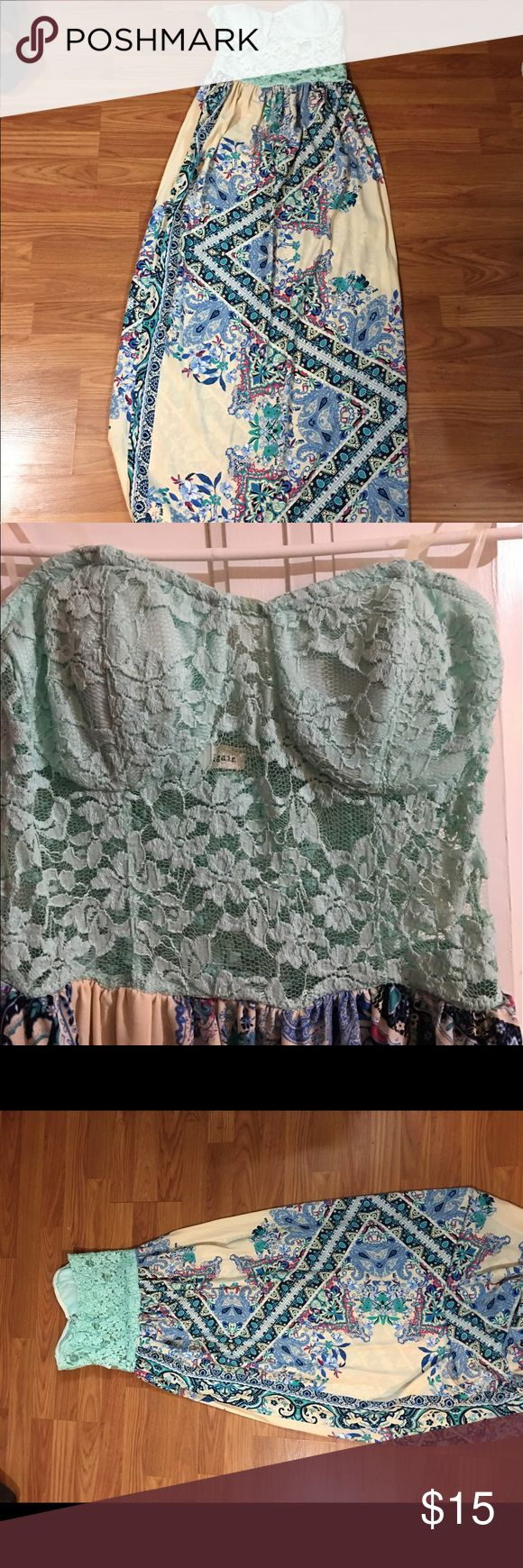 Turquoise maxi dress Cute turquoise maxi dress with paisley bottom and lace top. Never worn, I purchased the dress while on vacation and didn't try it on. I'm a 36C and the top was too small for my chest for reference. a.gain Dresses Maxi