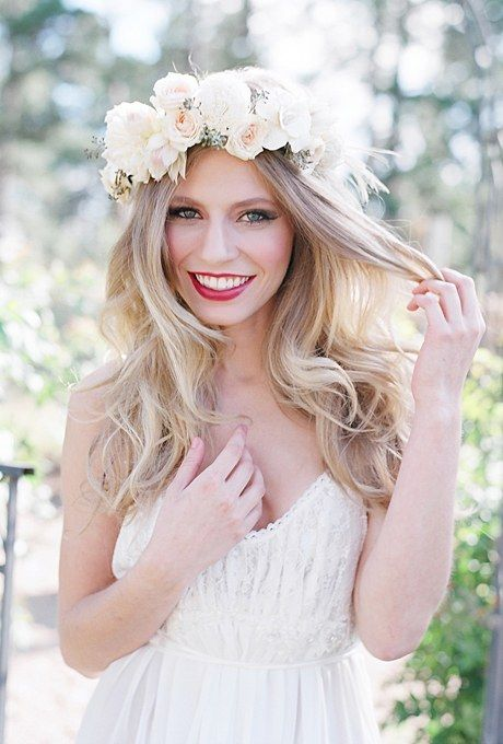 If bold colors don't feel bridal enough for your wedding day look, go for a neutral color palette of white, cream, and blush. And flower crowns don't get more wedding-worthy than this wreath of blush spray roses, blushing bride protea, sola shell flowers, and seeded eucalyptus created by Bare Root Flora.