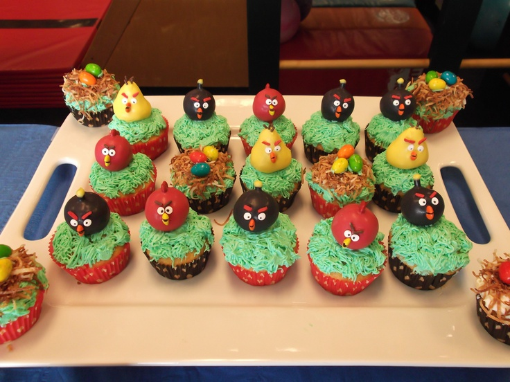 """The final Angry Bird pop display - I cut the sticks and then stuck the pops into """"grass"""" cupcakes. Also did a few """"nests"""" with toasted coconut and bubble gum eggs :): Cakes Pop, Pop Display, Coconut, Bubbles Gum, Birds Pop, Gum Eggs, Final Angry, Angry Birds Cupcake, Bubble Gum"""