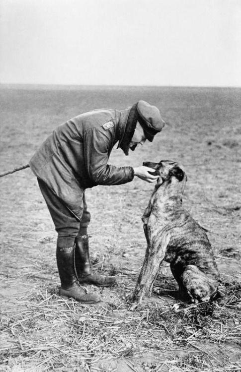 © IWM (Q 50673) Manfred von Richthofen stroking his pet dog, Moritz.