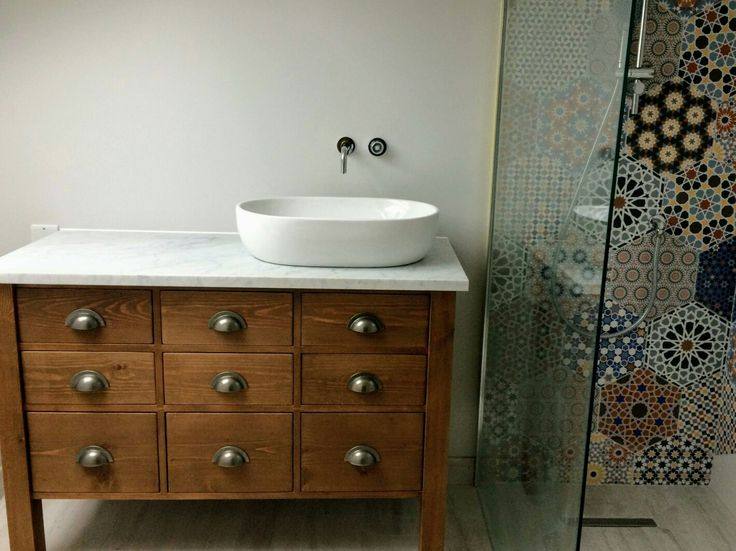 Vanity Unit - Bianco Carrara Surface. Top & middle row traditional drawers, bottom drawers set on soft-shut runners. All drawers functional despite allowance for pipework. Dovetails (Cabinet Makers) Limited @dovetailsathome #dovetailsathome