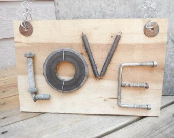"Charming ""Love"" sign, metal word art, old rough cut poplar wood, old fencing, rusty bolts, peterbilt parts, and other things from the farm"