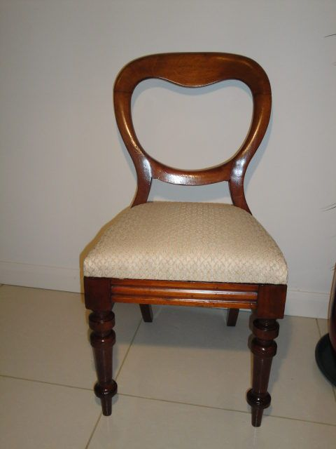 Not this style of chair - but similar timber and colours in the image....