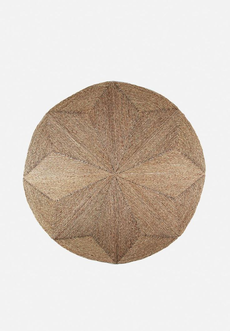 Give your space that cosy, lived-in feel with the simple addition of a seagrass rug. Constructed in a circular shape, this all-natural accent can live both in and outside, and incorporates a geometric weave within the design.