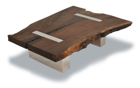 The Walnut Coffee Table – Polished Aluminum Legs is made with a single salvaged wood slab. The free edge was kept as part of the wood top design, creating an interesting contrast with the polished straight cut metal base. The raw look of the walnut slab, in contrast with the highly finished metal base makes the table a unique and elegant contemporary piece.