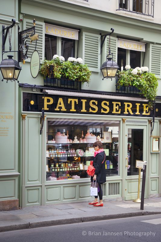 Window shopping at Ladurée Pâtisserie in Saint Germain des Près, Paris France. © Brian Jannsen Photography