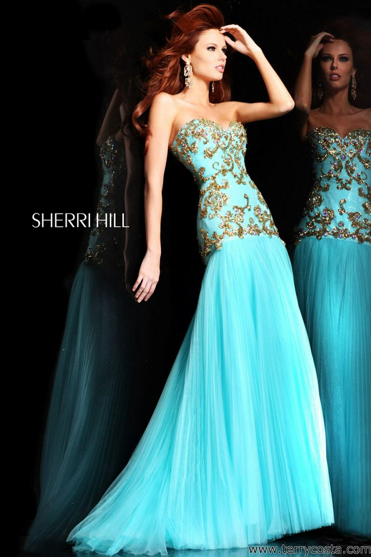 Sherri Hill 2973 on @Terry Song Costa - Gorgeous! This floor length prom dress features a sweetheart strapless neckline, dropped waist bodice and pleated skirt.