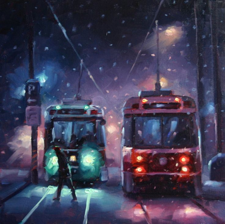 Two Toronto Streetcars at Queen's Quay on a snowy evening.