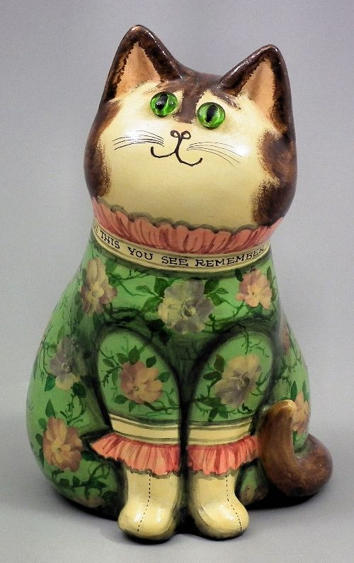 Papier-mache cat with green glass eyes, painted and decoupage decoration - by Joan and David de Bethel, 1976