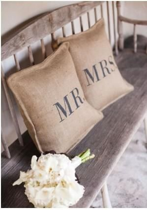 Cute throw pillows on rustic bench