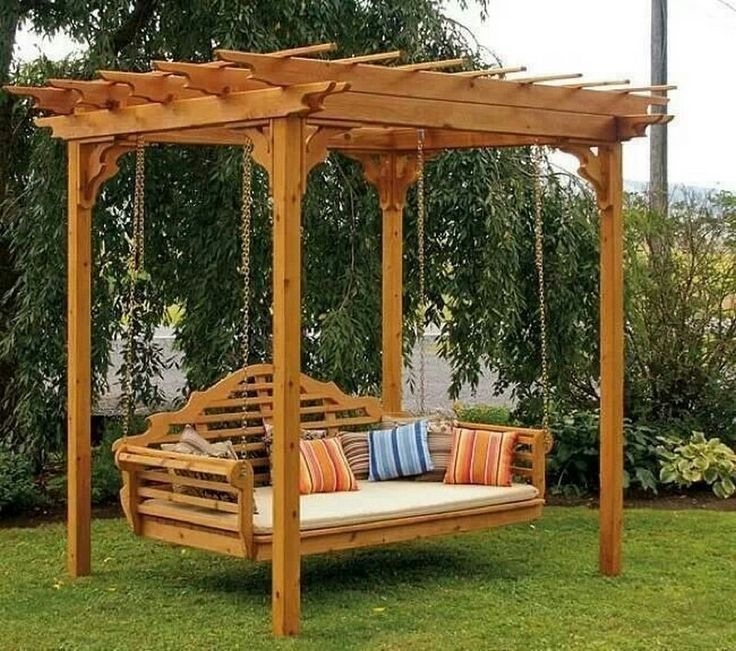 Hanging Wooden Chairs On Open Pergola With Colorful Cushion And Green Grass: Pergola Plans Ideas For Outdoor Remodel Decorating