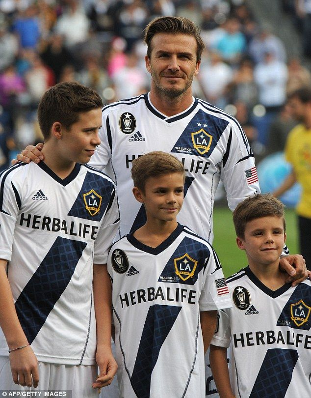 A proud David Beckham lines up with his sons Brooklyn (left), Romeo (centre) and Cruz before kick-off