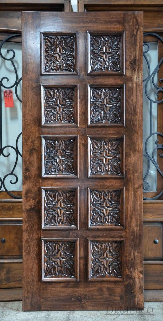 The Puerta Hoja Square Top is a multi-panel door featuring hand carved Spanish designs.