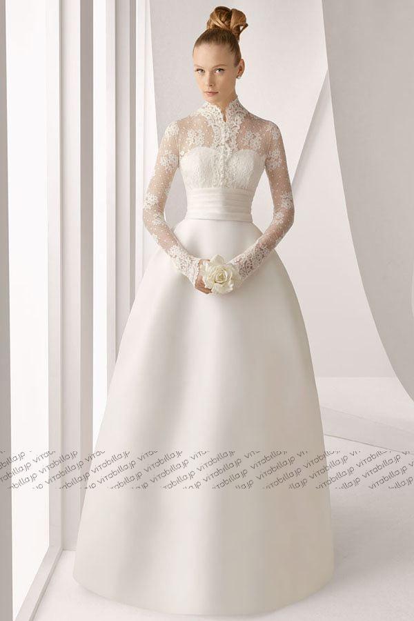 選び抜いた素材、全身をバランスよく見せるシルエット、細部にまでこだわりの極みを追求した品格のあるデザインで身にまとうヒロインの魅力を引き出す。すべてのドレスは十数年の経験を持つエキスパートたちの心のこもった手作りによるパーフェクトの一着。 Aライン ウェディングドレス スタンドカラー ブラシトレーン サテン ホワイト