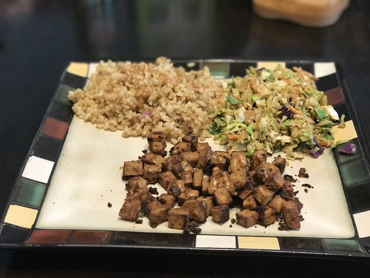 Dinner was delicious!! 😋😋😋  Brown rice, shredded Brussels sprouts, broccoli slaw (shredded broccoli, carrots and cabbage) in a spicy peanut sauce with crispy tofu!   #vegan #tofu #rice #brusselsprouts #wfpb