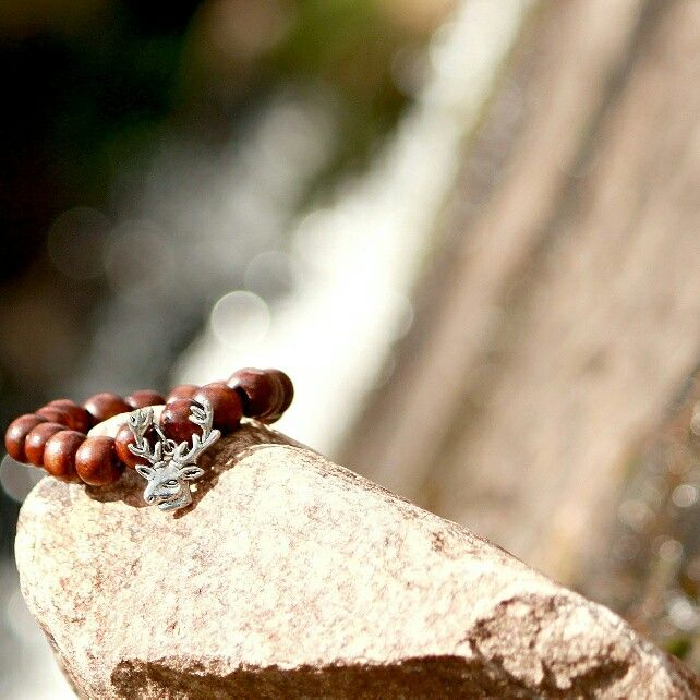 This silver deer bracelet was made with dark brown  wooden beads. The beads can be smaller upon request. Taken at the waterfall at Ben Hope. Photo by Pamela Taylor Photography. Rosering Creations x