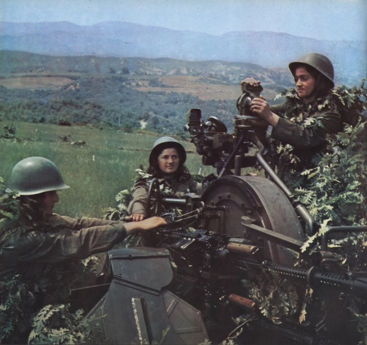 Female soldier of the Albanian People's Army operating a ZPU-4 anti-aircraft gun.