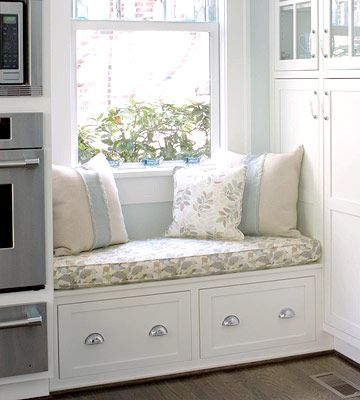 Kitchen window seat with storage below. So cute.