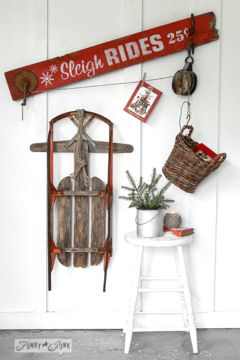 Sleigh Rides Christmas card holder with antique pulley, created with Funky Junk's Old Sign Stencils / funkyjunkinteriors.net/ funkyjunkinteriors.net