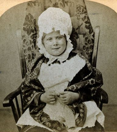 "Laura made me do it! When Lauralemur posted two charming card photographs of little girls dress as grandmothers  it sent me to my stereo chard collection looking for cards with the same theme that I remembered.  This is a curved buff card published by Littleton View Company. The image was copyrighted by F. G. Weller in 1875. I have more than one version of this little girl in her ""granny"" costume and her knitting. It was common practice to make several negatives so that more could b..."
