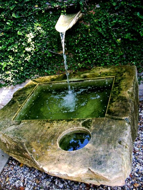 Stone water feature / green home....beautiful!!!