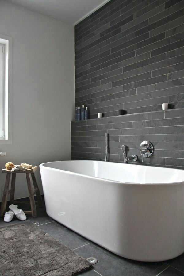 Concrete look tiles... all throughout upstairs showers?