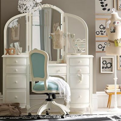 I just loved the feminine quality of this beautiful vanity set.  The chair gives it a nice pop of color.  (and what girl doesn't love Tiffany Blue?)