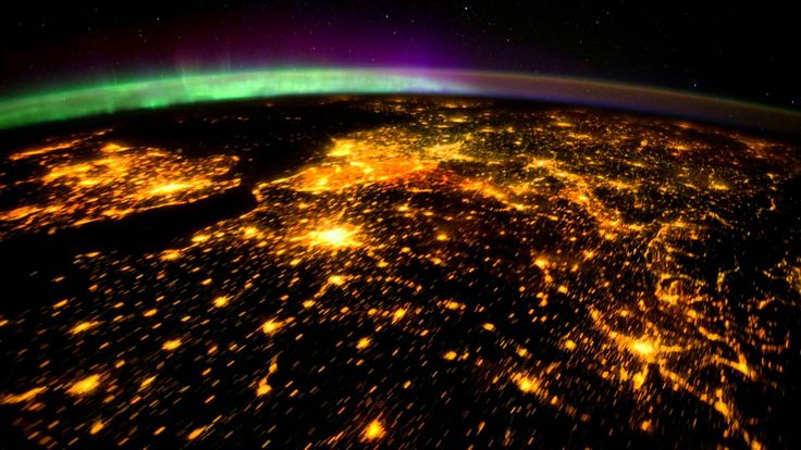 Planet Earth seen from Space (ISS), mainly at night, with aurora boreali...