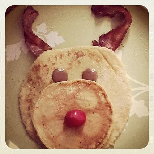 Cute! Rudolph Pancakes.  Make with paleo flours, and use fruit or paleo-friendly chocolate chips for eyes and nose.