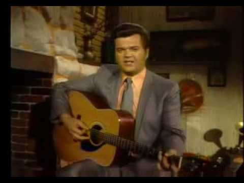 Conway Twitty - Hello Darlin'. Nothing like good ol' tear jerking country songs.