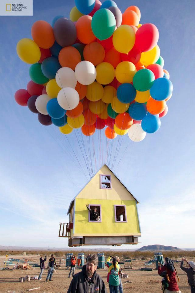 """Nat'l Geographic Channel + scientists & engineers + 2 world class balloon pilots = a successfully launched house """"UP"""" style! They used 300 8ft colored weather balloons & it set a new world record for the largest balloon cluster flight ever attempted. The house & balloons measured more than 10 stories high & reached an altitude of over 10,000 feet, flying for approximately one hour. The record will be part of a new National Geographic Channel series called """"How Hard Can It Be?"""" premiering in 2012: The National, Floating House, Real Life, Up House, The Real, National Geographic, World Records, Pixar Movies, Balloon"""