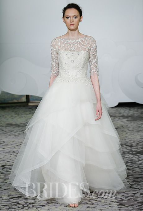 A ball gown wedding dress by @rivini with a tiered tulle skirt | Brides.com
