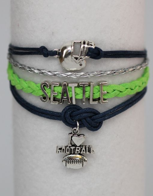 """Cheer for your favorite football team with our Seattle ModWrap! Navy blue, bright green, and silver with silver charms. Bracelet is 6 inches long with a 2 inch extender. Are you one of the Seattle 12th? If this Seattle Football ModWrap notes """"Available on backorder"""", it will be shipped on Tuesday, January 27th."""