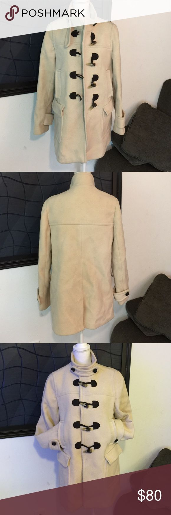 🎀EUC, L, Banana Republic, Cream, Wool, Pea Coat🎀 🎀Beautiful, EUC, Large, Banana Republic, Cream, Tea Length, 100% Wool Pea Coat.  This is a gorgeous, very high quality coat.  The lining feels like silk and is 100% acetate.  The coat has 4 toggle closures as well as a collar that is removable but can be buttoned for those extra cold days.  The coat has 4 pockets, 2 hand pockets right below the chest area & 2 larger ones below them.  This coat is elegant & perfect for a nice date night but…