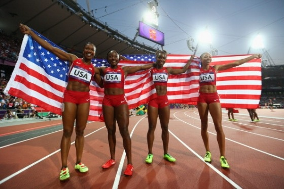 Carmelita Jeter of the United States, Bianca Knight of the United States, Allyson Felix of the United States and Tianna Madison of the United States celebrate after winning gold and setting a new world record of 40.82 afterthe Women's 4 x 100m Relay Final on Day 14 of the London 2012 Olympic Games at Olympic Stadium on August 10, 2012 in London, England.