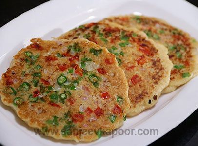 Oats Uttapam. Blend oats with water. Add gram flour, yogurt mix and cook like pancake. Sprinkle capsicum, onions, red chillies