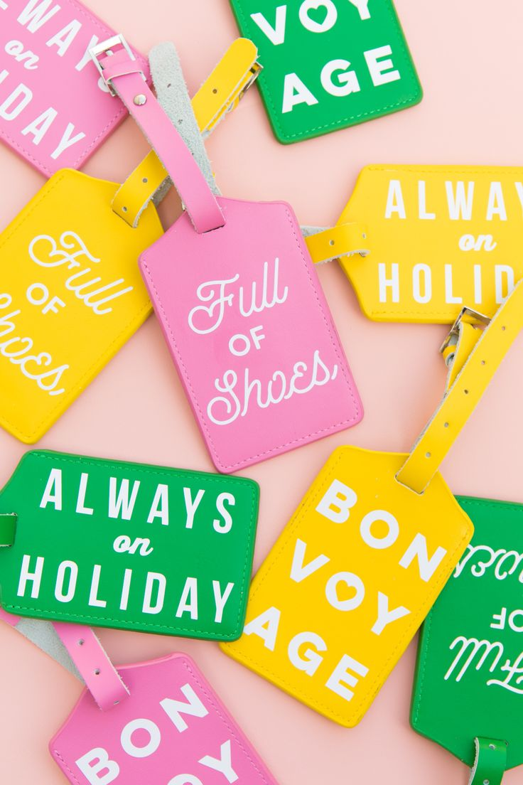 Learn how to make your own colorful typographic luggage tags using your Silhouette or Cricut cutting machine and never have a hard time identifying your bag at luggage claim again!