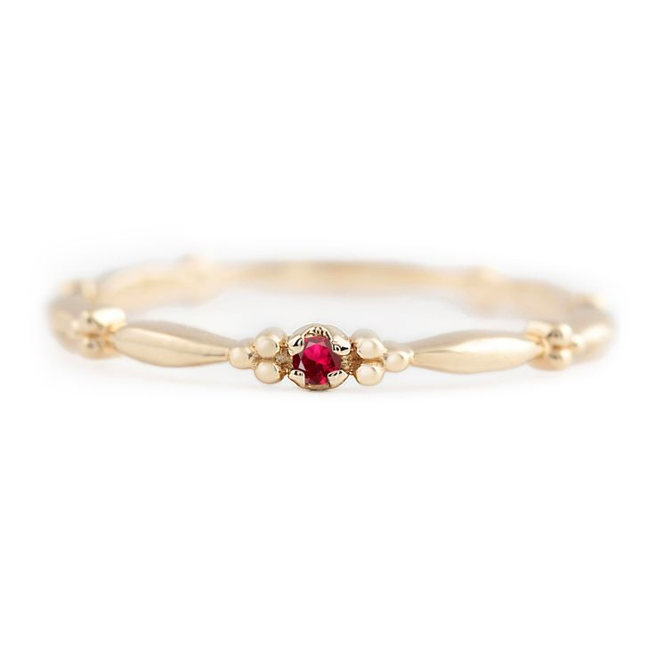 Unique 14k gold Ruby solitaire ring. This ring is unlike any other, the band has interesting design all around which makes this simple Ruyb ring so different from other dainty rings. Giving a bit of a