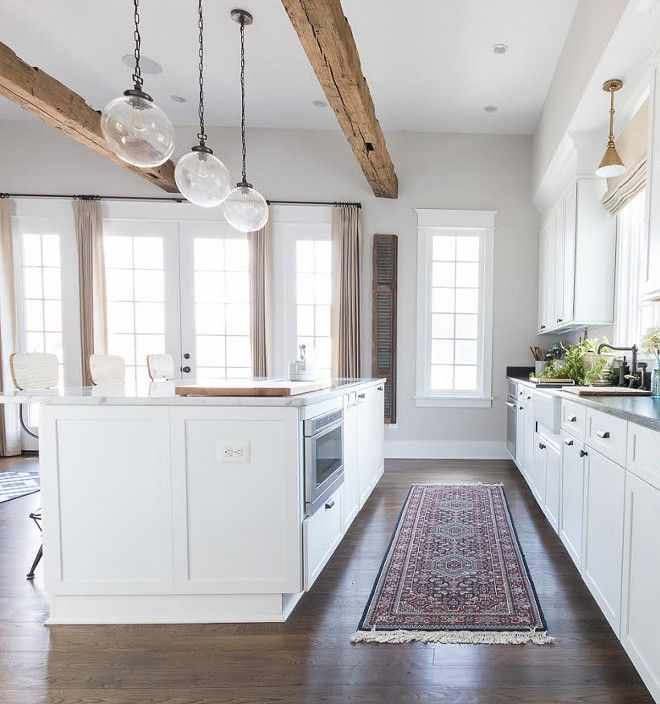 """Similar """"planks"""" to wrap beam in kitchen. No lighting on beam - large pendant will go on either side of beam"""