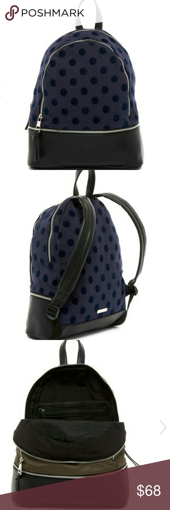 "MADDEN GIRL navy polka dot backpack This adorable backpack is done in fabric and faux leather with faux leather details. The bottom zipper is only for decoration. However, the bag does feature two compartments. Like the olive bag posted prior, it features adjustable shoulder straps and a top handle. Dimensions are: 16"" high, 12"" wide, 4.5"" deep with a 3"" handle drop and 6-16"" shoulder strap drop. This bag is perfect for everyday use. Madden Girl Bags Backpacks"