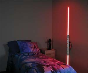 The Star Wars nerd in me WANTS this Darth Maul Lightsaber Lamp (Darth Maul was one of my two favorites!)