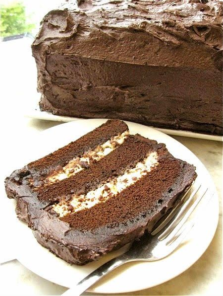 Chocolate Cassata - dense chocolate cake, filled with sweetened ricotta cheese and chocolate chips, and iced with creamy fudge frosting.