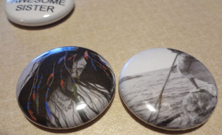1 inch pinback charms of Native American woman.  The lady on the right is a Nootka woman fishing.  It was posted in the newspaper a few weeks. #nativeamerican #1inchcharm #identity