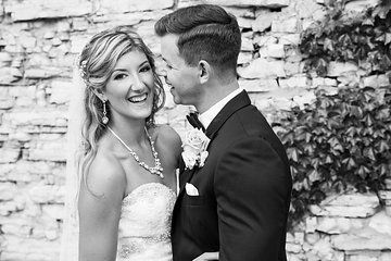 Black & White wedding photo by a stone wall  Photo from Leah & Daniel collection by Grace and Gold Studios