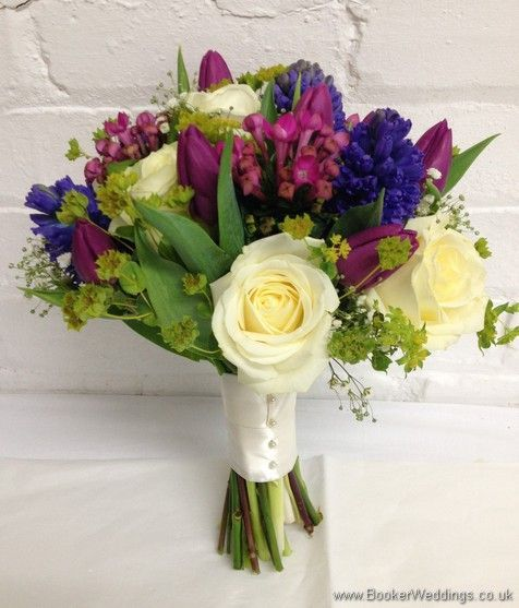 Spring Mix Pinks Purples and Blues Bridal Bouquet with Ivory rose, purple tulips, blue hyacinth, gypsy grass, pink bouvardia Side View  Wedding Flowers Liverpool, Merseyside, Bridal Florist, Booker Flowers and Gifts, Booker Weddings