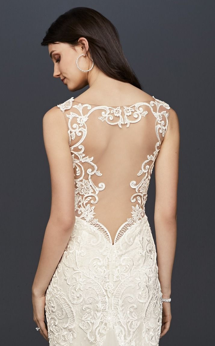 The look of lace, especially this pretty, is a wedding look we will always love. | Plunging Illusion Bodice Lace Sheath Wedding Dress by Galina Signature available at David's Bridal